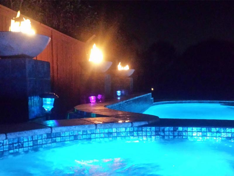 View From The Spa With Blue LED Lights and Fire Pots